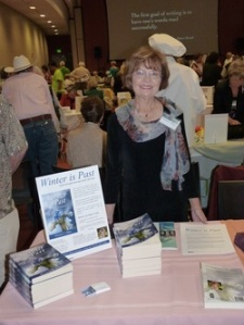 Victoria C. Slotto present her novel at a book fair.