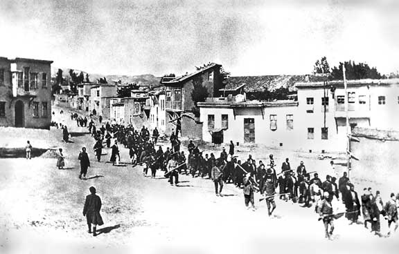 Armenians are marched to a nearby prison in Mezireh by armed Turkish soldiers. Kharpert, Armenia, Ottoman Empire - April, 1915. *From the collection of Project SAVE Armenian Photograph Archives. Photographed by an anonymous German traveler.