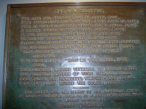 The bronze plaque inscribed with Emma Lazarus' poem, The New Colassus.